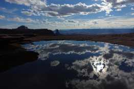 Clouds reflected in a small pool, Island in the Sky, Canyonlands National Park