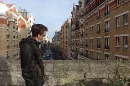 Kyle regards a pigeon on the Promenade Plantée