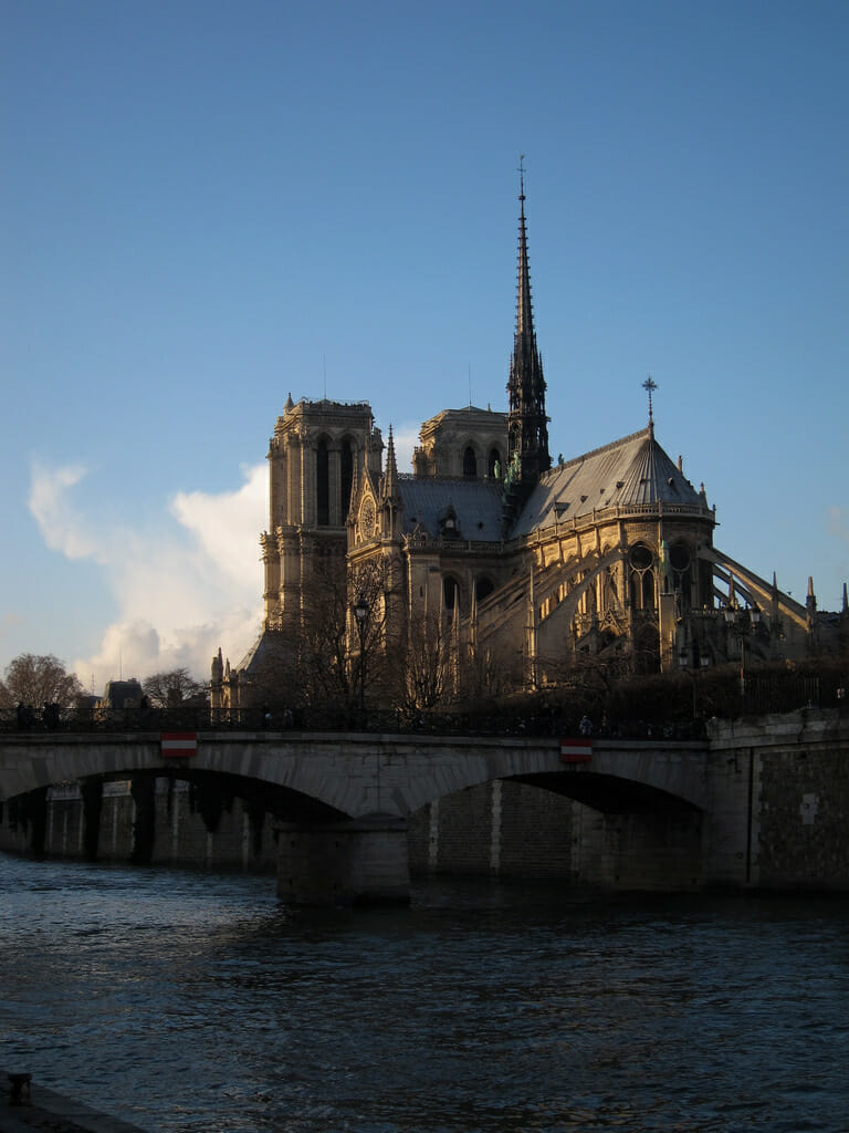 Notre Dame cathedral and the Seine at dusk