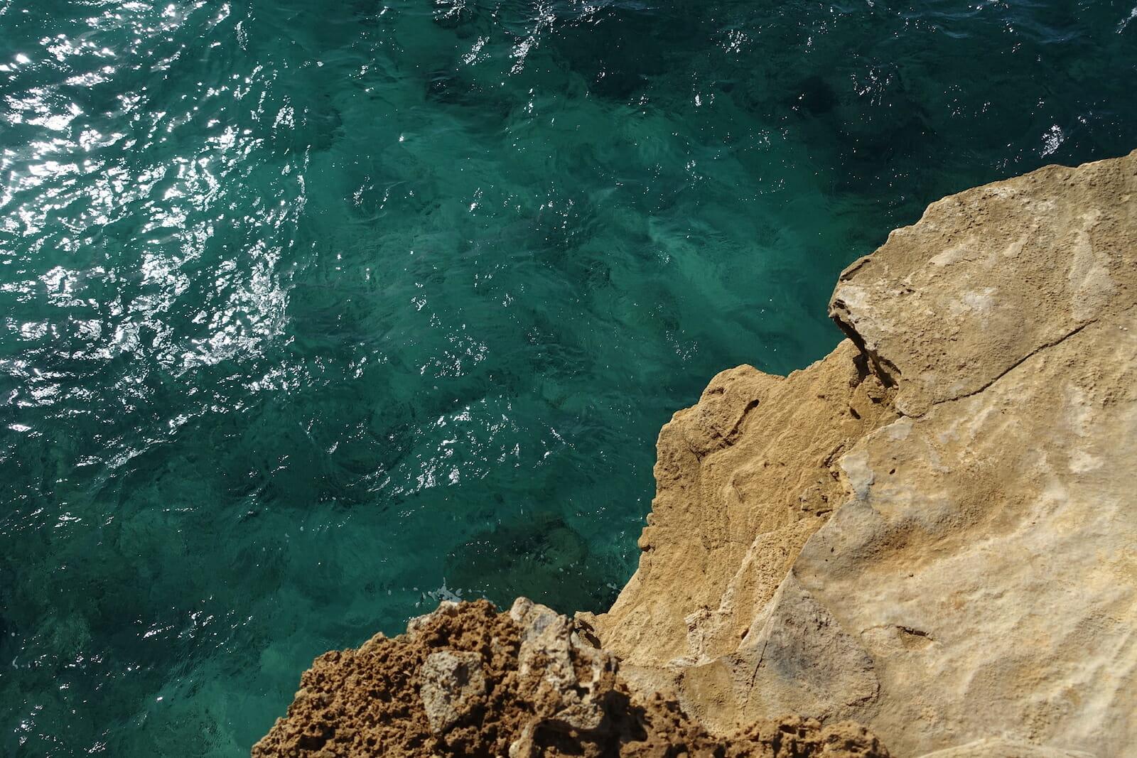 blue water and limestone along the Maha'ulepu Heritage Trail, Kauai