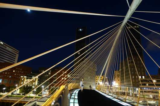 Puente Zubizuri, Bilbao, illuminated at night.