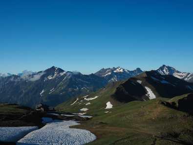 Refuge de la Croix du Bonhomme surrounded by mountains