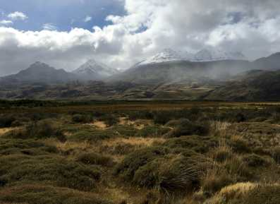 Parting snowclouds in Valle Chacabuco, over peaks from the southern edge of Reserva Nacional Lago Jeinimeni