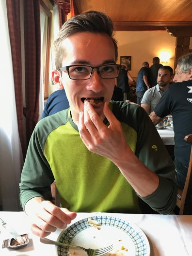 Kyle eats nutella and cookie as part of breakfast at Hotel Croux