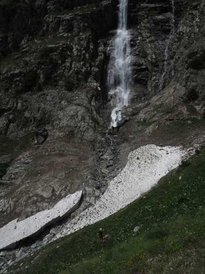 Kyle stands near a waterfall formed by Torrent de Treutse Bô