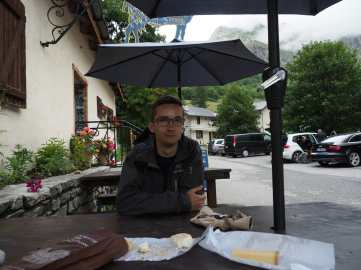 Kyle, with cheese and baguette, in Les Chapieux