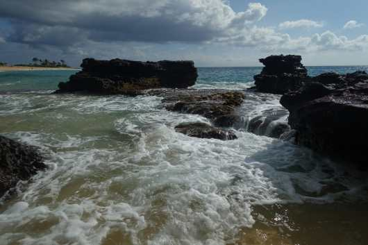 Waves and tide pools at Sandy Beach