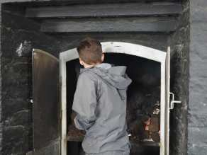 Adding peat to the fire at Laphroaig