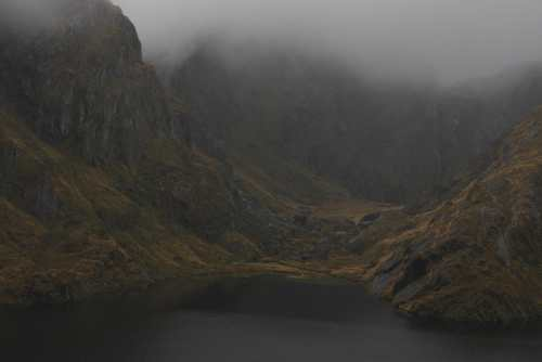 The Routeburn Track's Lake Harris in the rain and clouds, New Zealand