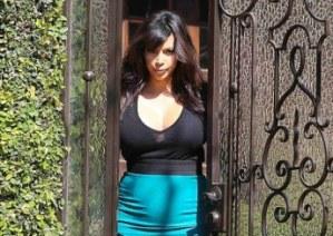 Pregnant Kim Kardashian in Figure-Hugging Pencil Skirt