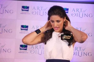 Pix: Nargis Fakhri Gives Tips for Art of Oiling at Parachute Oil Event