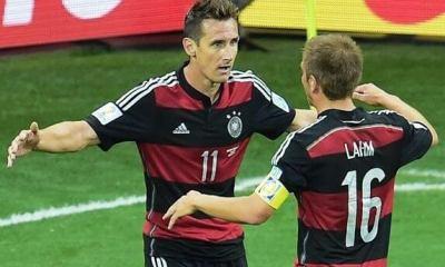 Jogadores alemaes comemoram gol contra o Brasil / Odd Andersen/AFP