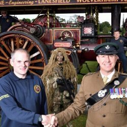 Tom Sanders, Steam Engine Secretary of the County of Salop Steam Engine Society with Captain Nicholas Vazquez. Rally committee members Don Metcalfe and Michael Llewellyn with the Burrell steam traction engine, and members of  8 Rifles KSLI.