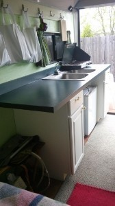 woman-converts-cargo-trailer-to-stealth-micro-camper-kitchen-600x1067