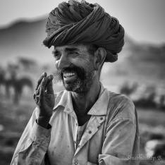 The Happy Ranger: Dusty hot desert day. Tattered clothes. Much hard work lined up. The laughter though, is no holds barred.