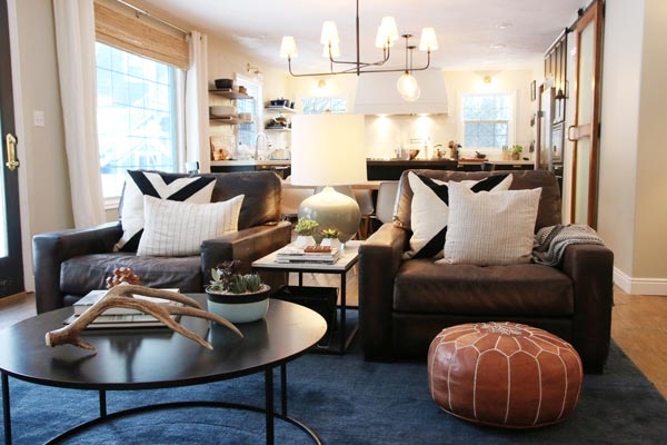 Feel Free To Use Eclectic Decor In Your Rustic Living Room Like The Antler Decoration On This Coffee Table