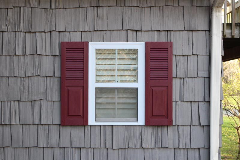 Exterior vinyl house shutters combination style installed.