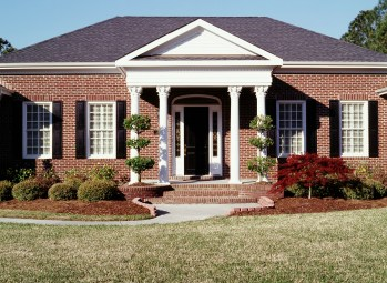 custom-exterior-shutters-brick-home
