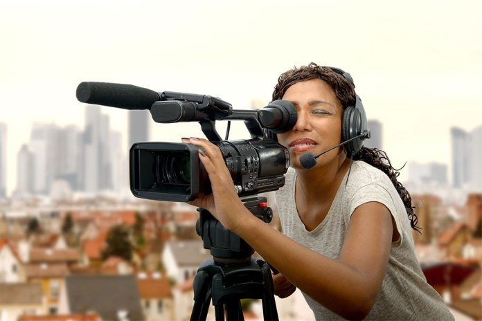 Woman Filming on Set.