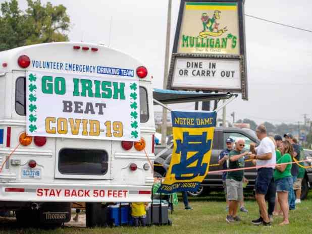 September 12, 2020;  Notre Dame, Indiana, USA;  Fans gather off-campus for a game between the Notre Dame Fighting Irish and the Duke Blue Devils at Notre Dame Stadium.  Notre Dame has limited seating capacity and banned tailgating on campus as part of its COVID-19 protocol.