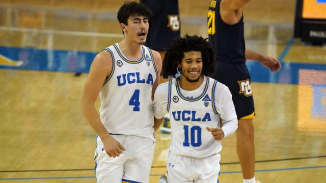 UCLA guards Jaime Jaquez Jr. and Tyger Campbell celebrate during UCLA's win against Marquette.