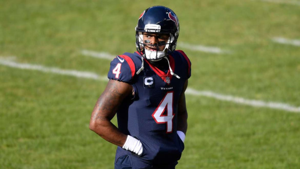 Deshaun Watson walks off the field during a game against the Bears
