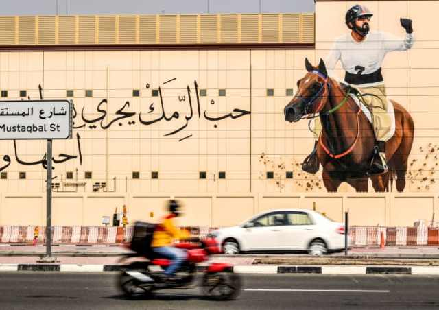 The sheikh's equestrian image looms in Dubai.