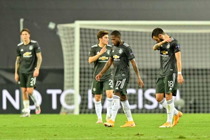 Fred and Bruno Fernandes of Manchester United look dejected following their sides defeat in the UEFA Europa League Semi Final between Sevilla and Manchester United at RheinEnergieStadion on August 16, 2020 in Cologne, Germany.