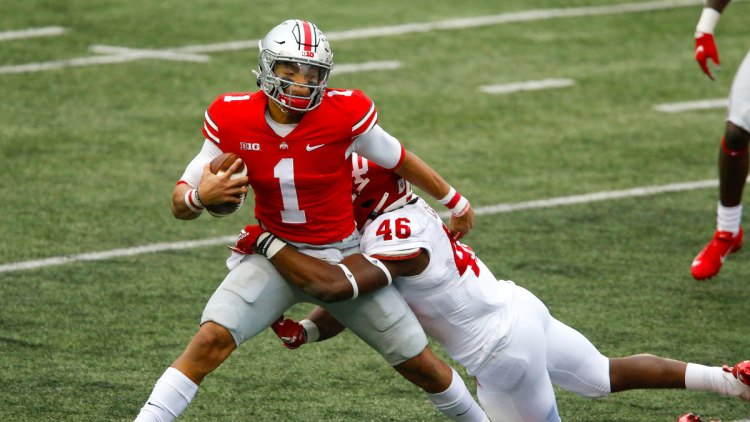 Ohio State QB Justin Fields gets wrapped up by an Indiana defender