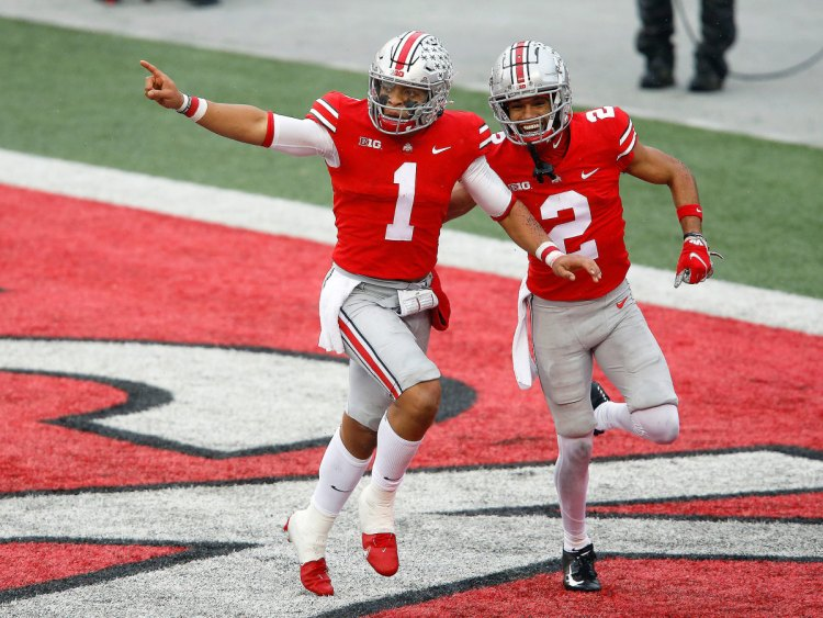 Ohio State's Justin Fields and Chris Olave celebrate a touchdown vs. Indiana