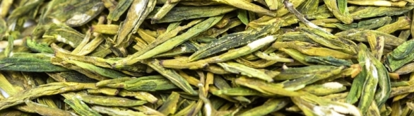 Wild Spring Long Jing Green Tea, dry leaves closeup