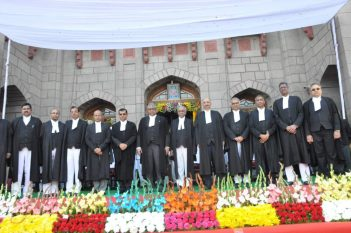 Governor ESL Narasimhan administrating oath to Thottathil B Radhakrishnan as first Chief Justice of the Telangana High Court, at the Raj Bhavan in Hyderabad on Tuesday. Chief Minister Sri K Chandrashekhar Rao is also present