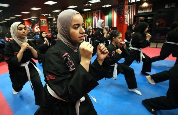 Kuwaiti women practise hybrid martial art Kajukenbo in a club in Kuwait City on October 22, 2018. - Kajukenbo was born in Hawaii in the 1940s. The sport's name was derived from the various aspects of martial arts it includes: karate (KA), judo and jujitsu (JU), kenpo (KEN) and boxing (BO). (Photo by Yasser Al-Zayyat / AFP)