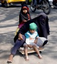 A handicap woman beggar along with her two children can be seen crossing the road where her daughter seems to be extra cautious for her mother while crossing. This shows the utter attachment of the girl with her handicap mother.Photo:Laeeq