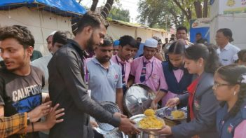Students of TSMRS (Telangana State Minorities residential School) distributing Food packets among the effected shop holders on the third day of the major fire at Numaish Grounds Nampally in Hyderabad:Photo:Laeeq