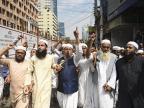 Bangladeshi Muslims condemn shooting at the mosques in Christchurch. PHOTO: AFP
