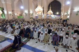 Muslims offering Taraweeh prayers at historic Mecca Masjid on Monday night