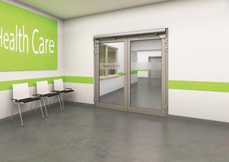 Um berührungslose Türöffnung zu ermöglichen, kommen automatische Drehtürantriebe oft in Krankenhäusern zum Einsatz.
