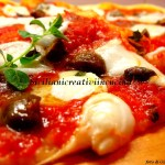 Pizza with mozzarella, olives, capers and anchovies