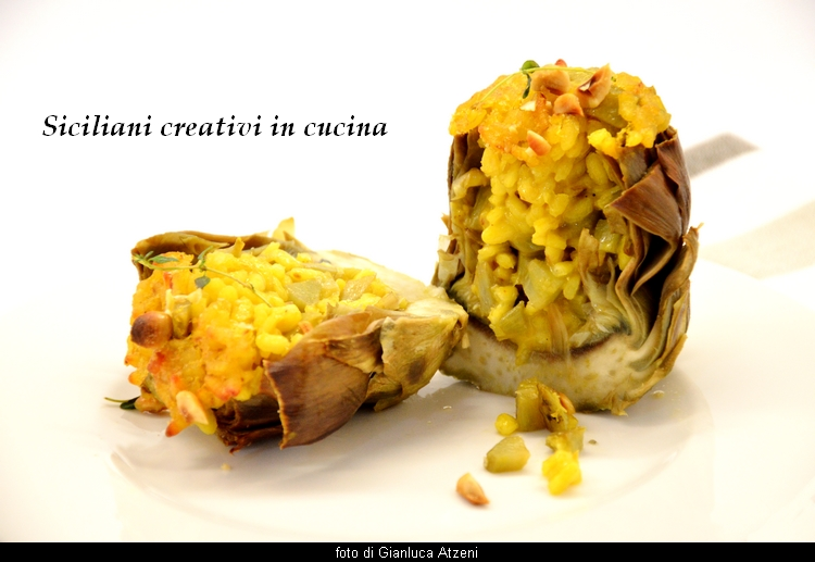 Stuffed artichokes with saffron risotto. An original and alternative way of filling the artichokes, with a creamy and tasty risotto. They can be served as an appetizer or first course, perfect for buffets.