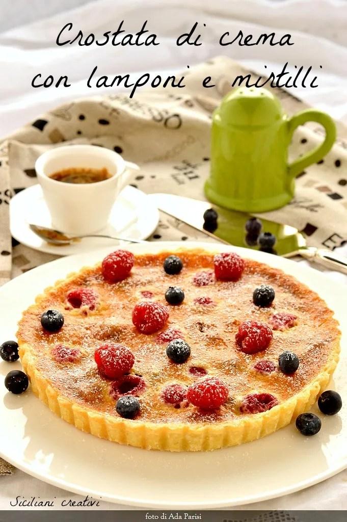 Cream tart with raspberries and blueberries