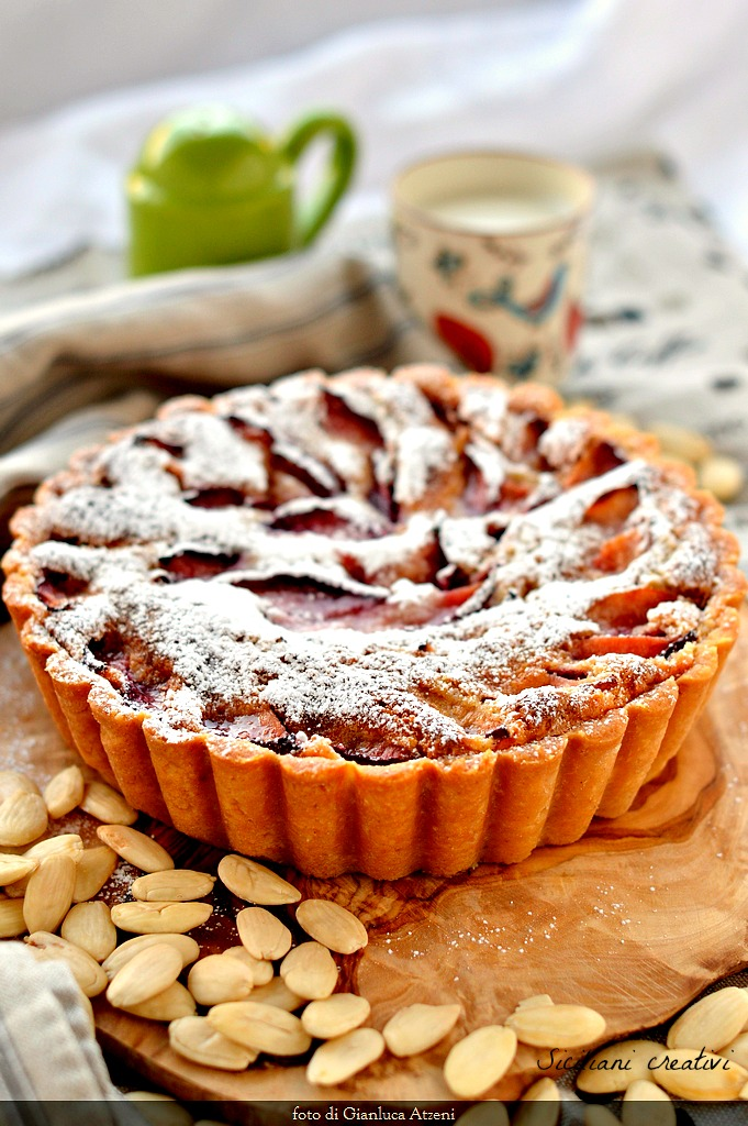 Frangipane tart with cream and fresh plums