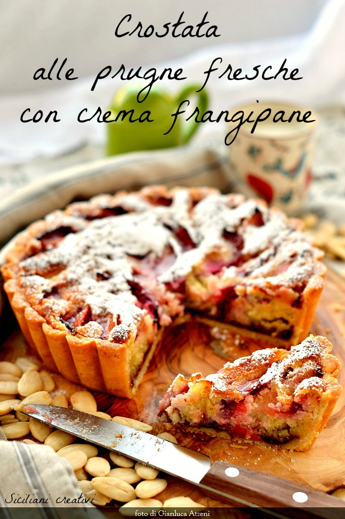 Frangipane tart with cream and plums