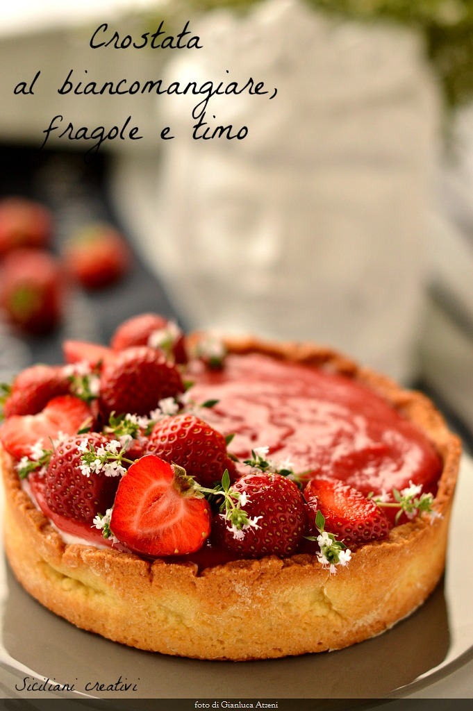 Tart white eating strawberries and thyme