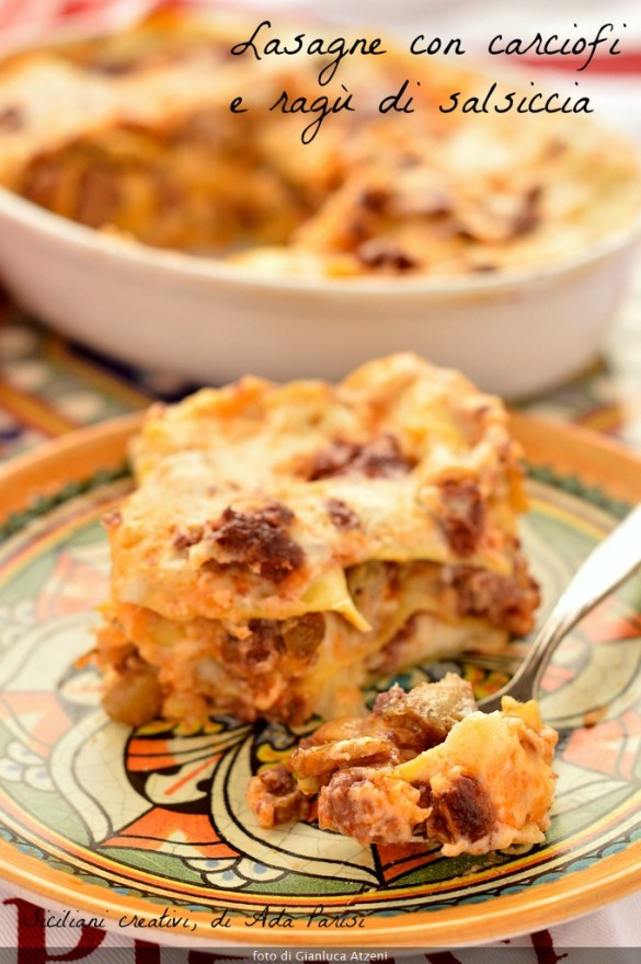 A generous portion of white lasagna with artichokes and sausage sauce