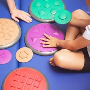 Occupational Therapy in Toronto, child playing with sensory disks
