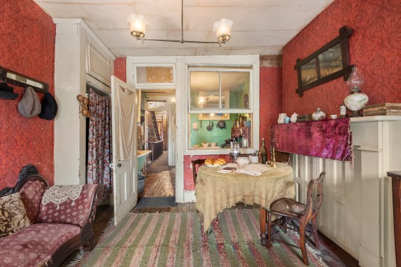 The Rogarshevskys and their six children lived in three rooms at 97 Orchard Street in the 1910s. This view looks out to the tenement's staircase. Photo by Ryan Lahiff, courtesy of the Tenement Museum