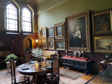 The dining room at Olana mixes Middle Eastern and European styles, including fake Old Masters that Church chose deliberately.