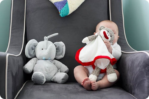 baby playing with sock monkey