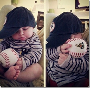 baby in baseball hat